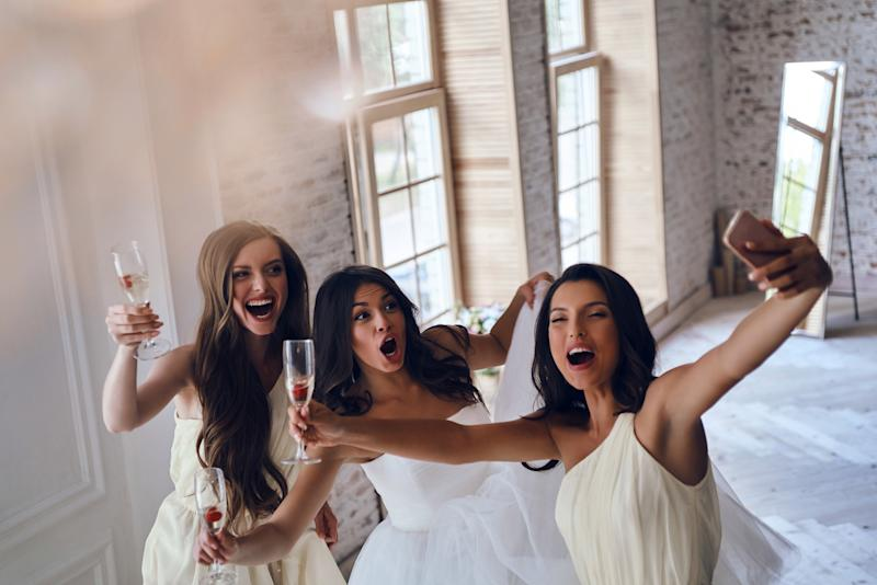 Don't post more than 5 pictures of your big day, says Tatler [Photo: Getty]