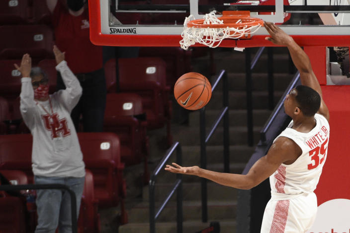 Houston forward Fabian White Jr. (35) dunks during the first half of an NCAA college basketball game against South Florida, Sunday, Feb. 28, 2021, in Houston. (AP Photo/Eric Christian Smith)