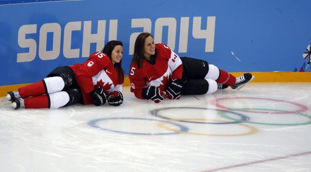 Canada's Melodie Daoust (L) and Lauriane Rougeau from the national ice hockey women's team pose for a picture during a training session at the Shayba Arena in preparation for the 2014 Sochi Winter Olympics, February 6, 2014. The women's ice hockey competition begins on February 8. REUTERS/Grigory Dukor (RUSSIA - Tags: SPORT OLYMPICS ICE HOCKEY)
