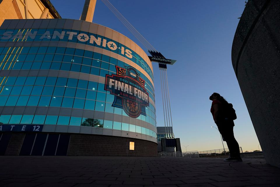 A visitor looks up at the logo for the Women's Final Four in San Antonio.