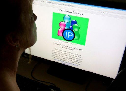 A woman looks at a website designed to check for problems stemming from malware known as DNS Changer