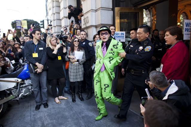 SAN FRANCISCO, CA - NOVEMBER 15: San Francisco police officers arrest the Riddler with the help of 5-year-old leukemia survivor Miles, also known as BatKid November 15, 2013 in San Francisco. Make-A-Wish Greater Bay Area foundation turned the city into Gotham City for Miles by creating a day long event bringing his wish to be a BatKid to life. (Photo by Ramin Talaie/Getty Images)