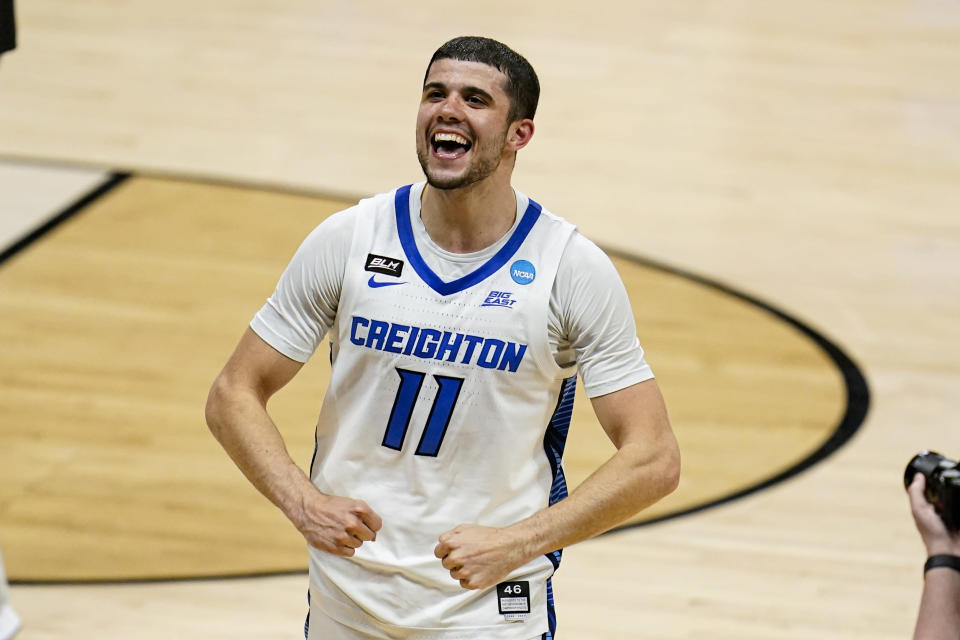 Creighton guard Marcus Zegarowski (11) celebrates following a 72-58 win over Ohio a second round game in the NCAA men's college basketball tournament at Hinkle Fieldhouse in Indianapolis, Monday, March 22, 2021. Creighton defeated Ohio 72-58. (AP Photo/Michael Conroy)