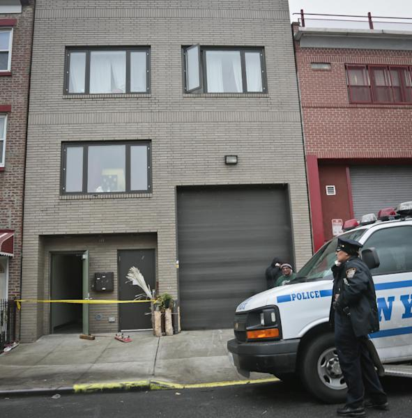 "A police vehicle parks outside the location of a Monday shooting rampage, Tuesday, Nov. 12, 2013 in Brooklyn, New York. Police said gunman Ali Akbar Mahammadi Rafie, 29, a musician, killed himself on the roof after shooting to death two members of the Iranian indie rock band Yellow Dogs, a third musician and wounding a fourth person early Monday morning. The shooter was a member of another band from Iran, the Free Keys, who knew the victims but hadn't spoken to them in months because of a ""petty conflict,"" according to Yellow Dogs manger Ali Salehezadeh. (AP Photo/Bebeto Matthews)"