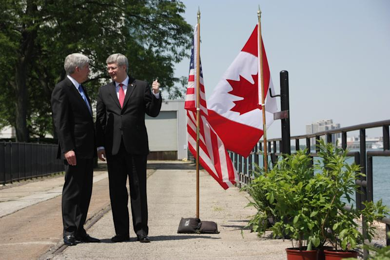 Prime Minister Stephen Harper and Michigan Gov. Rick Snyder speak in Windsor, Ontario, Canada on Friday, June 15, 2012, ahead of an announcement for a new $1-billion bridge connecting the city with Detroit. (AP Photo/The Canadian Press, Colin Perkel)