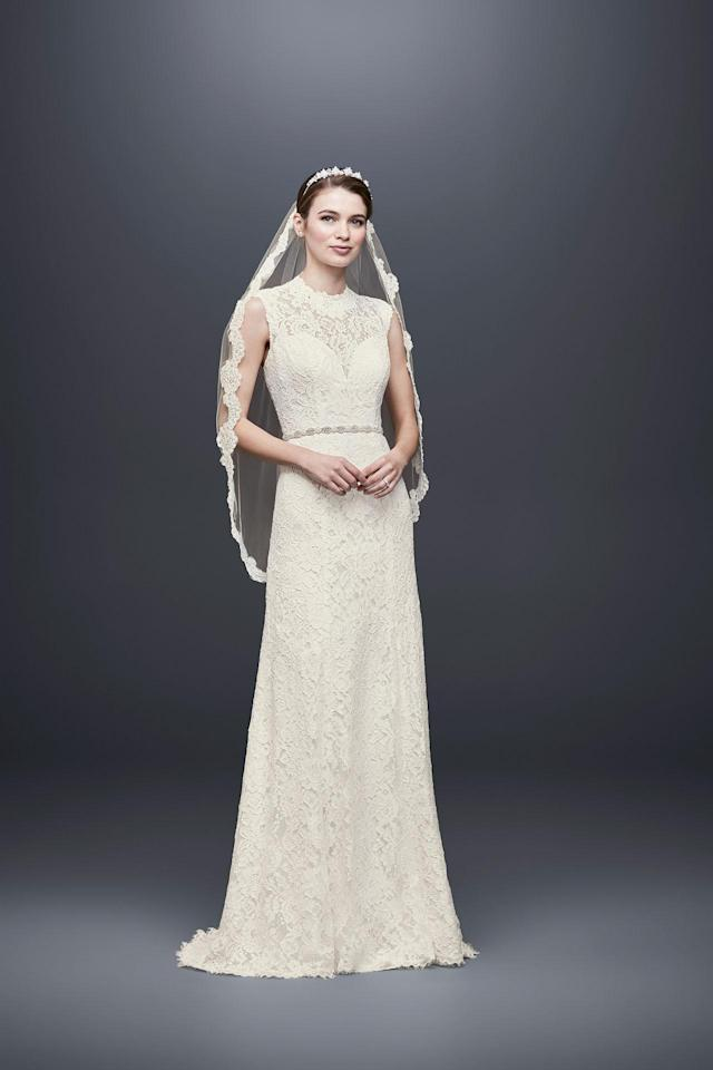 <p>Traditional-style lace, sleeveless dress with veil. (Photo: Courtesy of David's Bridal) </p>