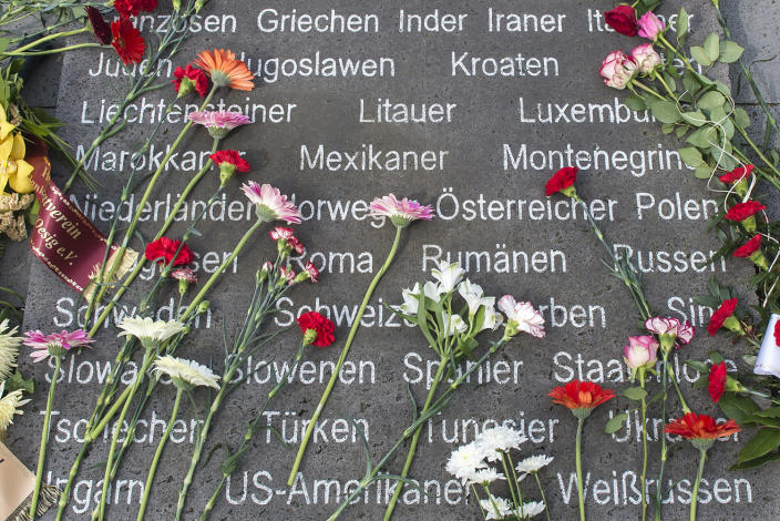 <p>Flowers cover a memorial stone with the engraved names of the different nationalities during the commemoration ceremonies for the 72th anniversary of the liberation of former Nazi concentration camp Mittelbau-Dora near Nordhausen, central Germany, Monday, April 10, 2017. (Photo: Jens Meyer/AP) </p>