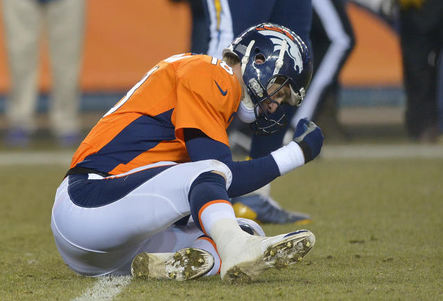 Denver Broncos quarterback Peyton Manning (18) pounds his fist on the ground after throwing an interception against the San Diego Chargers in the fourth quarter of an NFL football game, Thursday, Dec. 12, 2013, in Denver. San Diego won 27-20. (AP Photo/Jack Dempsey)