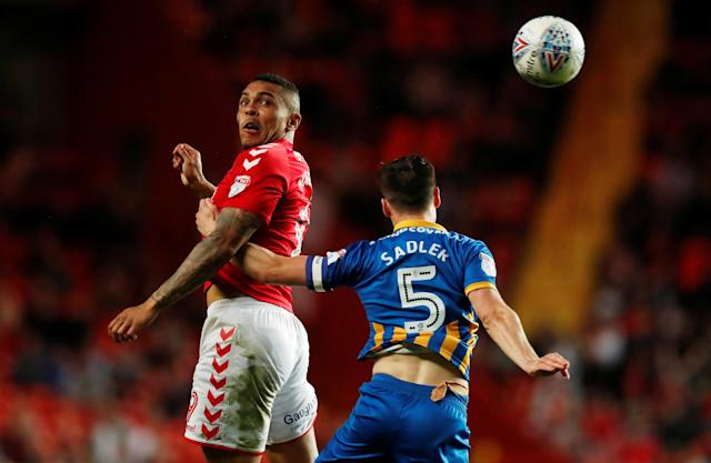 "Soccer Football - League One Play Off Semi Final First Leg - Charlton Athletic vs Shrewsbury Town - The Valley, London, Britain - May 10, 2018 Charlton Athletic's Josh Magennis in action with Shrewsbury Town's Mat Sadler Action Images/Peter Cziborra EDITORIAL USE ONLY. No use with unauthorized audio, video, data, fixture lists, club/league logos or ""live"" services. Online in-match use limited to 75 images, no video emulation. No use in betting, games or single club/league/player publications. Please contact your account representative for further details."
