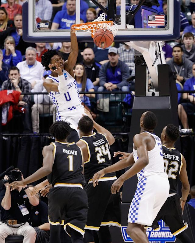 <p>De'Aaron Fox #0 of the Kentucky Wildcats dunks against the Wichita State Shockers in the second half during the second round of the 2017 NCAA Men's Basketball Tournament at the Bankers Life Fieldhouse on March 19, 2017 in Indianapolis, Indiana. The Kentucky Wildcats won 65-62. (Photo by Joe Robbins/Getty Images) </p>