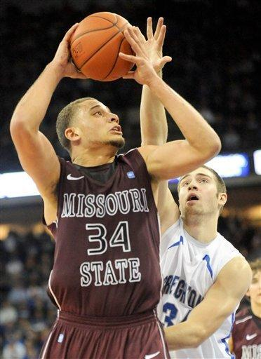 Missouri State's Kyle Weems drives past Creighton's Ethan Wragge (34) during their NCAA college basketball game Wednesday Dec 28, 2011 in Omaha, Neb. (AP Photo/Dave Weaver)