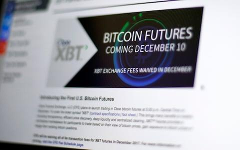 The Chicago Board Options Exchange website announces that bitcoin futures will start trading on the CBOE - Credit: AP