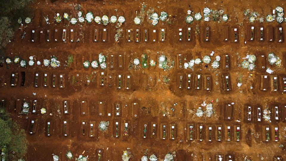 SAO PAULO, BRAZIL - JUNE 19: A drone photo shows Vila Formosa cemetery after bodies of Covid-19 victims are buried by officials in Sao Paulo, Brazil, on June 19, 2021. Brazil already has almost 500,000 COVID-19 deaths and shows no signs of a slowdown in the contagion. (Photo by Marcello Zambrana/Anadolu Agency via Getty Images)