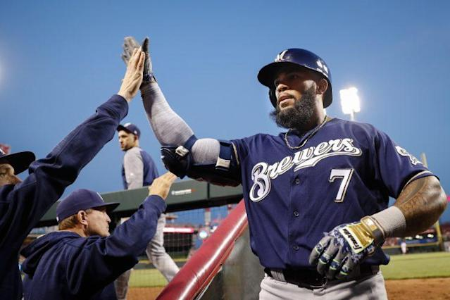 Eric Thames has been giving a lot of high fives in 2017. (AP)