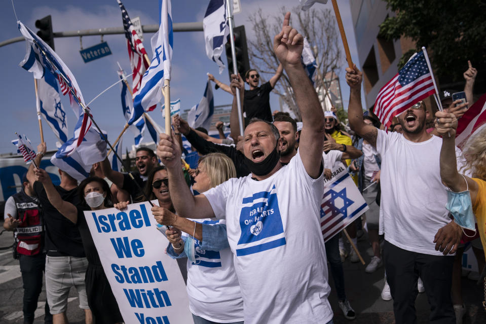 FILE - Pro-Israel supporters chant slogans during a rally in support of Israel outside the Federal Building in Los Angeles, Wednesday, May 12, 2021. A larger debate is playing out nationwide among many U.S. Jews who are divided over how to respond to the violence and over the disputed boundaries for acceptable criticism of Israeli policies. (AP Photo/Jae C. Hong, file)