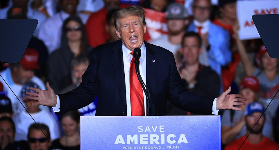 Donald Trump during a rally in Alabama, US, where he was booed for telling supporters to get vaccinated against Covid-19.