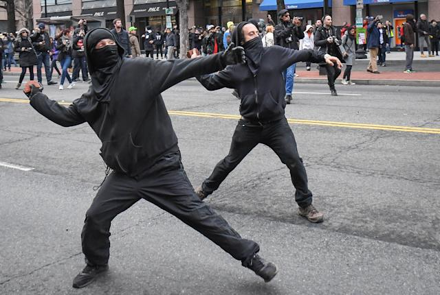 Protesters throw rocks at police during a protest near the inauguration of President Donald Trump in Washington, D.C., Jan. 20, 2017.