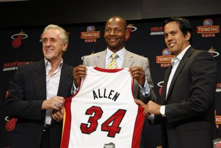 Miami Heat president Pat Riley, left, guard Ray Allen, center, and head coach Erik Spoelstra, right, hold up Allen's jersey after Allen signed an NBA basketball contract with the Heat. (AP)