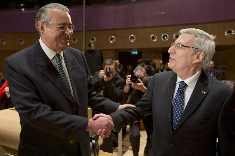 Peru's ambassador Allen Wagner, left, shakes hands with Chile's ambassador Albert van Klaveren Stork, right, prior to the start of hearings in a dispute between Peru and Chile over the two countries' maritime boundary at the International Court of Justice in The Hague, Monday Dec. 3, 2012. (AP Photo/Peter Dejong)