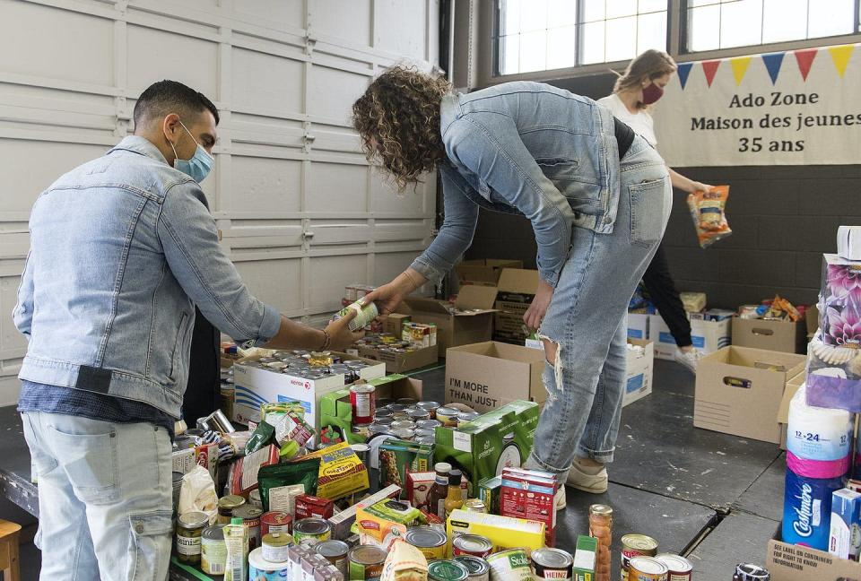 Volunteers sort through donated food items.