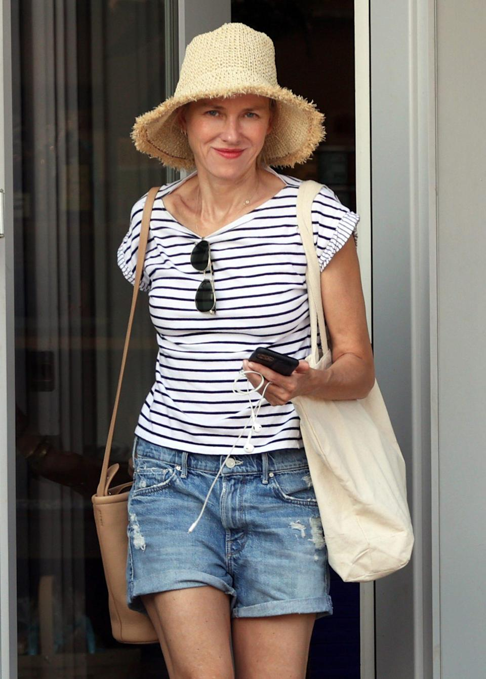 <p>Naomi Watts does some shopping in the Hamptons on July 27.</p>