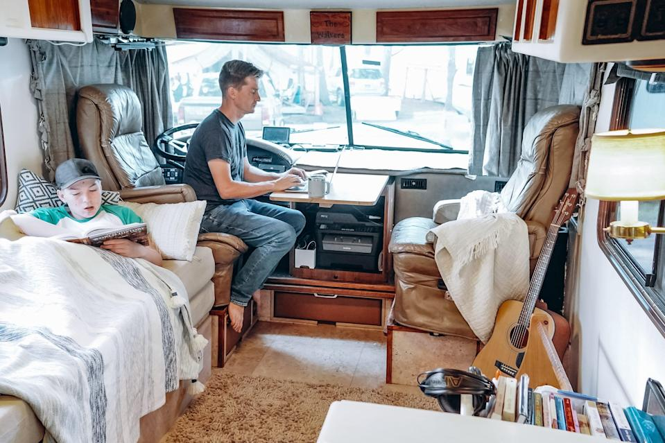 trent working in front of the walker family RV