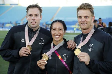 Rugby Sevens - Gold Coast 2018 Commonwealth Games - Men's Medals Ceremony - Robina Stadium - Gold Coast, Australia - April 15, 2018. Gold medalists Sarah Goss, Scott Curry and Tim Mikkelson of New Zealand pose with medals. REUTERS/Paul Childs