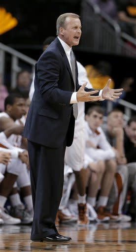 Texas coach Rich Barnes talks to his players during the first half an NCAA college basketball game against TCU in the Big 12 men's tournament Wednesday, March 13, 2013, in Kansas City, Mo. (AP Photo/Charlie Riedel)