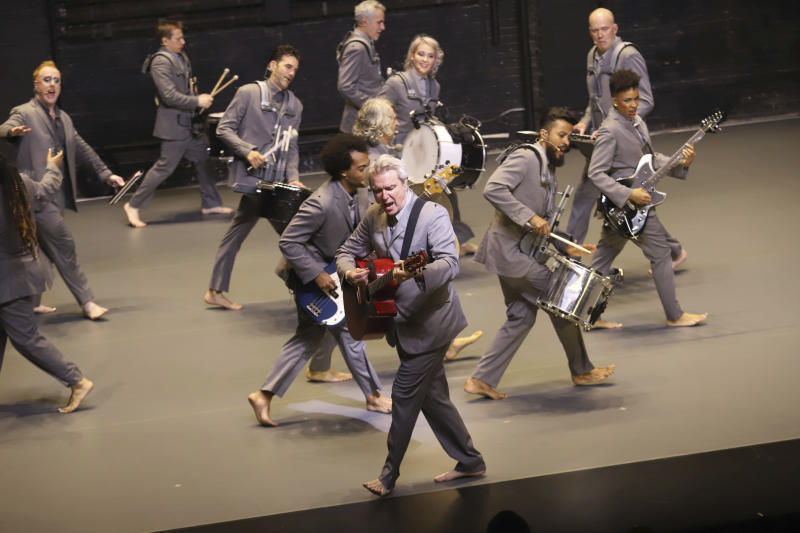 """David Byrne appears on stage during the Broadway opening night curtain call of """"David Byrne's American Utopia"""" at the Hudson Theatre on Sunday, Oct. 20, 2019, in New York. (Photo by Greg Allen/Invision/AP)"""
