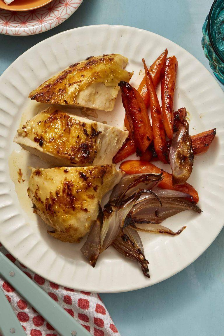 """<p>If you're looking for a simple main dish to serve on Mother's Day, consider this one pan chicken, spiced up with cumin seed and ginger.</p><p><a href=""""https://www.womansday.com/food-recipes/food-drinks/a26345659/spiced-roast-chicken-with-caramelized-carrots-and-shallots-recipe/"""" rel=""""nofollow noopener"""" target=""""_blank"""" data-ylk=""""slk:Get the recipe for Spiced Roast Chicken with Caramelized Carrots and Shallots."""" class=""""link rapid-noclick-resp""""><em>Get the recipe for Spiced Roast Chicken with Caramelized Carrots and Shallots.</em></a></p>"""