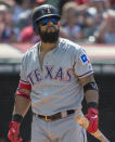 Texas Rangers' Rougned Odor walks to the dugout after Cleveland Indians relief pitcher Brad Hand struck him out during the ninth inning of the first game of a baseball doubleheader in Cleveland, Wednesday, Aug. 7, 2019. The Indians won the game 2-0. (AP Photo/Phil Long)