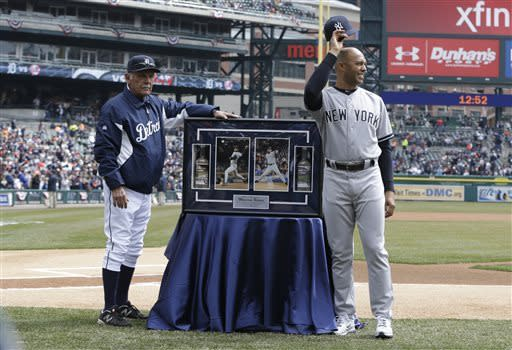 New York Yankees relief pitcher Mariano Rivera acknowledges the crowd with Detroit Tigers manager Jim Leyland after being presented a frame with photographs of him pitching at Tiger Stadium and Comerica Park before a baseball game in Detroit, Sunday, April 7, 2013. (AP Photo/Carlos Osorio)