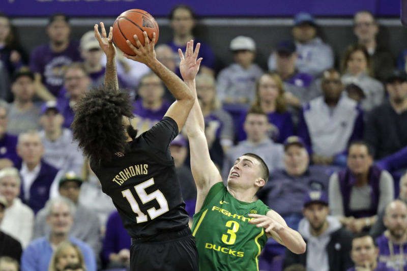Washington guard Marcus Tsohonis (15) shoots over Oregon guard Payton Pritchard (3) during the first half of an NCAA college basketball game, Saturday, Jan. 18, 2020, in Seattle. (AP Photo/Ted S. Warren)