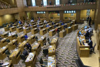 The Oregon House of Representatives get set to open a session on the evening of Thursday, June 10, 2021, to consider expelling member Rep. Mike Nearman for letting violent protesters into the Oregon Capitol in December. Republican lawmakers voted with majority Democrats to take the historic step of expelling the Republican member who let violent, far-right protesters into the state Capitol on Dec. 21. (AP Photo/Andrew Selsky)