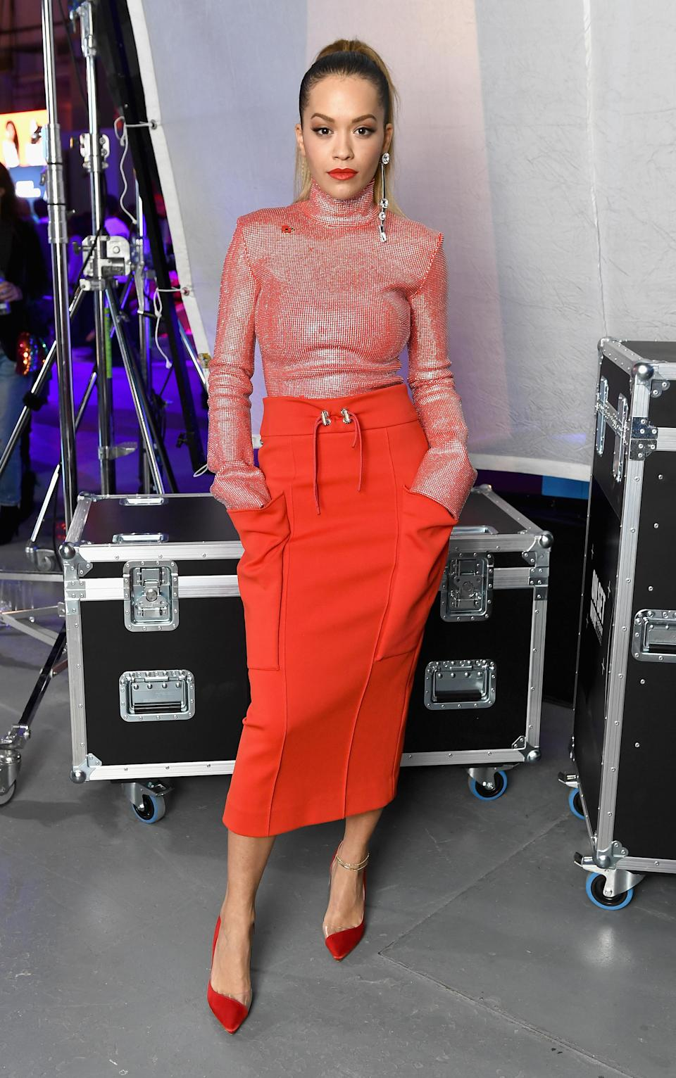 <p>Before the show started, the pop star posed in an all-red ensemble. <em>[Photo: Getty]</em> </p>