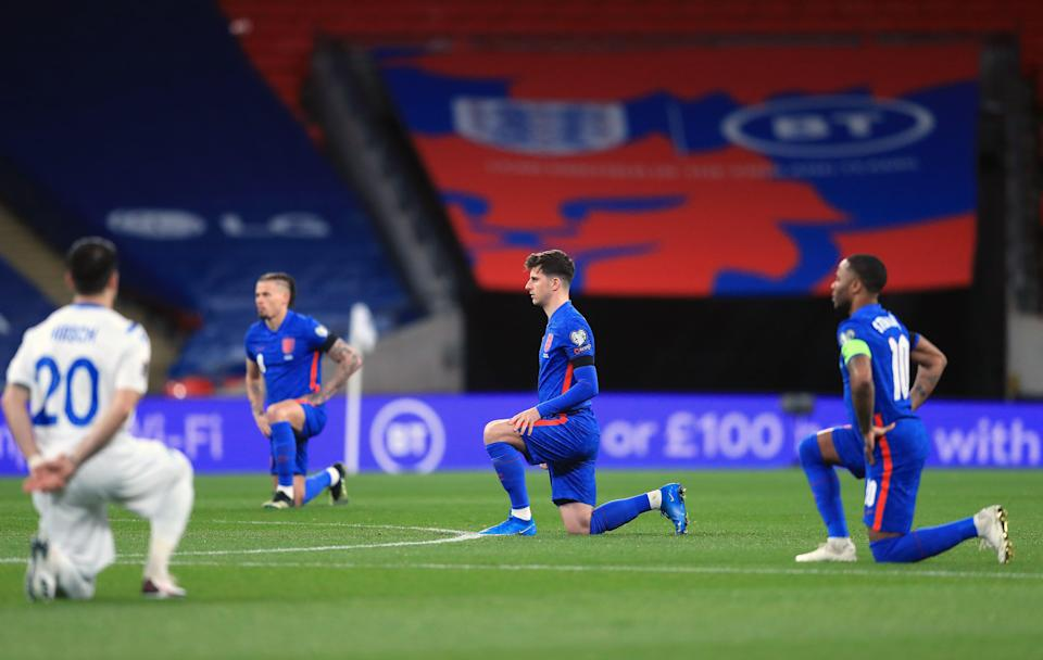 England take the knee ahead of a match (PA Wire)