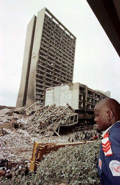 PHOTO: NAIROBI, KENYA: In this Aug. 7, 1998, file photo, a Kenyan guard looks at the site of a bomb blast at the US embassy in Nairobi that killed at least 111 people and injured more than 4,000. (Alexander Joe/AFP via Getty Images, FILE)