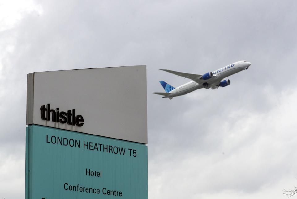 A plane passes over the Thistle Hotel at Heathrow. Prime Minister Boris Johnson is expected to approve plans to force some travellers arriving to the UK to quarantine in hotels to limit the spread of new coronavirus variants. Picture date: Tuesday January 26, 2021.