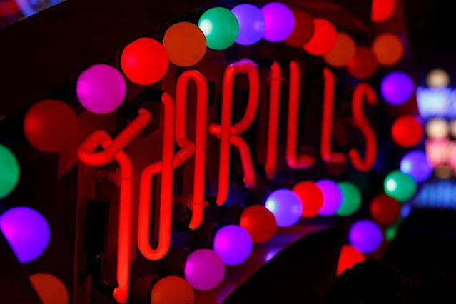 <p>A neon sign that reads 'Thrills' is exhibited in God's Own Junkyard gallery and cafe in London, Britain, March 31, 2017. (Photo: Russell Boyce/Reuters) </p>