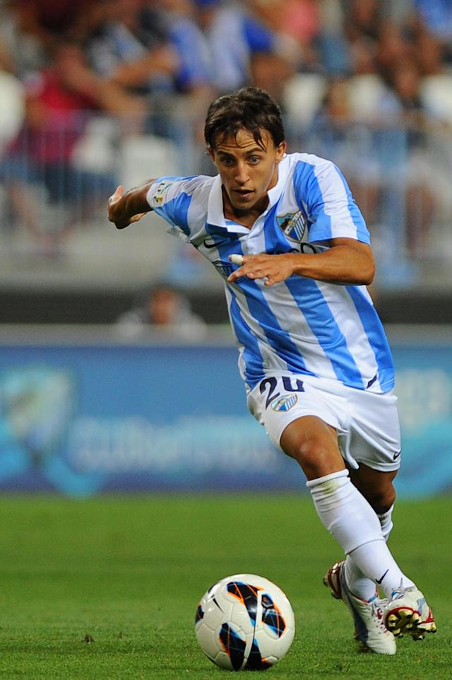 Malaga's Argentinian midfielder Diego Buonanotte controls the ball during the Trofeo Costa del Sol football match Malaga CF vs Everton F.C. at the Rosaleda Stadium in Malaga on August 11, 2012. AFP PHOTO/ JORGE GUERREROJorge Guerrero/AFP/GettyImages