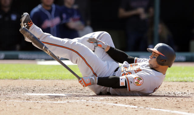 Baltimore Orioles' Welington Castillo falls to the ground after swinging against a pitch from Cleveland Indians relief pitcher Dan Otero in the seventh inning of a baseball game, Saturday, Sept. 9, 2017, in Cleveland. (AP Photo/Tony Dejak)