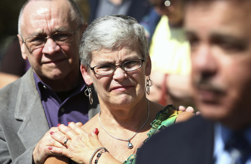 Kathy Chapman, a childhood friend of Maria Ridulph who was with her just before her disappearance in 1957, listens to Hiram Grau, director of the Illinois State Police, address the media in Sycamore, Ill., Friday, Sept. 14, 2012, following the guilty verdict of Jack McCullough for the kidnapping and murder of 7-year-old Maria Ridulph, of Sycamore. The 72-year-old McCullough was convicted in one of the oldest unsolved crimes to eventually get to court in the U.S. (AP Photo/Daily Chronicle, Kyle Bursaw) MANDATORY CREDIT, CHICAGO LOCALS OUT, ROCKFORD OUT