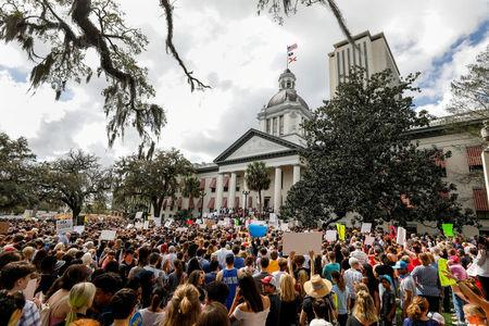FILE PHOTO: Protestors rally outside the Capitol urging Florida lawmakers to reform gun laws, in the wake of last week's mass shooting at Marjory Stoneman Douglas High School, in Tallahassee, Florida, U.S., February 21, 2018. REUTERS/Colin Hackley/File Photo