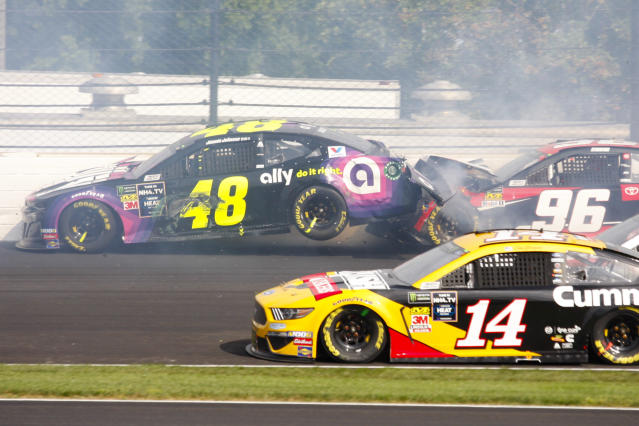 NASCAR driver Jimmie Johnson (48) is hit by Parker Kligerman (96) in the second turn during the NASCAR Brickyard 400 auto race at the Indianapolis Motor Speedway, Sunday, Sept. 8, 2019, in Indianapolis. (AP Photo/Mike Fair)