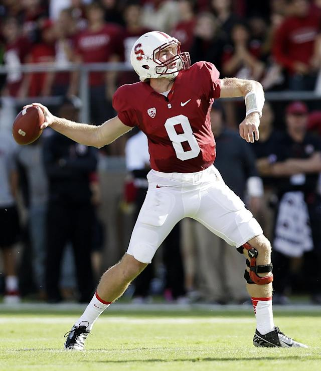 Stanford quarterback Kevin Hogan throws against Arizona State during the first half of an NCAA college football game Saturday, Sept. 21, 2013, in Stanford, Calif. (AP Photo/Marcio Jose Sanchez)