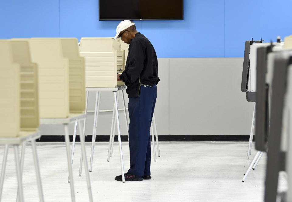 Robert Plant, Jr., 70, of Detroit, votes at the Detroit Service Learning Academy in the state's primary election, Tuesday morning, Aug. 3, 2021, in Detroit. (Clarence Tabb Jr./Detroit News via AP)