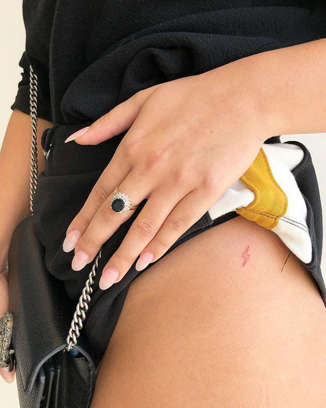 """<p>This bb lightening bolt is an adorable option for a Leo <a href=""""https://www.cosmopolitan.com/entertainment/celebs/a30692418/ariana-grande-butterfly-arm-tattoo-grammy-awards-pictures/"""" rel=""""nofollow noopener"""" target=""""_blank"""" data-ylk=""""slk:tattoo"""" class=""""link rapid-noclick-resp"""">tattoo</a>. Leos not only have a wild amount of energy, but <strong>they light up every room they walk in. </strong></p><p><a href=""""https://www.instagram.com/p/B2kFPa8lFUW/"""" rel=""""nofollow noopener"""" target=""""_blank"""" data-ylk=""""slk:See the original post on Instagram"""" class=""""link rapid-noclick-resp"""">See the original post on Instagram</a></p>"""