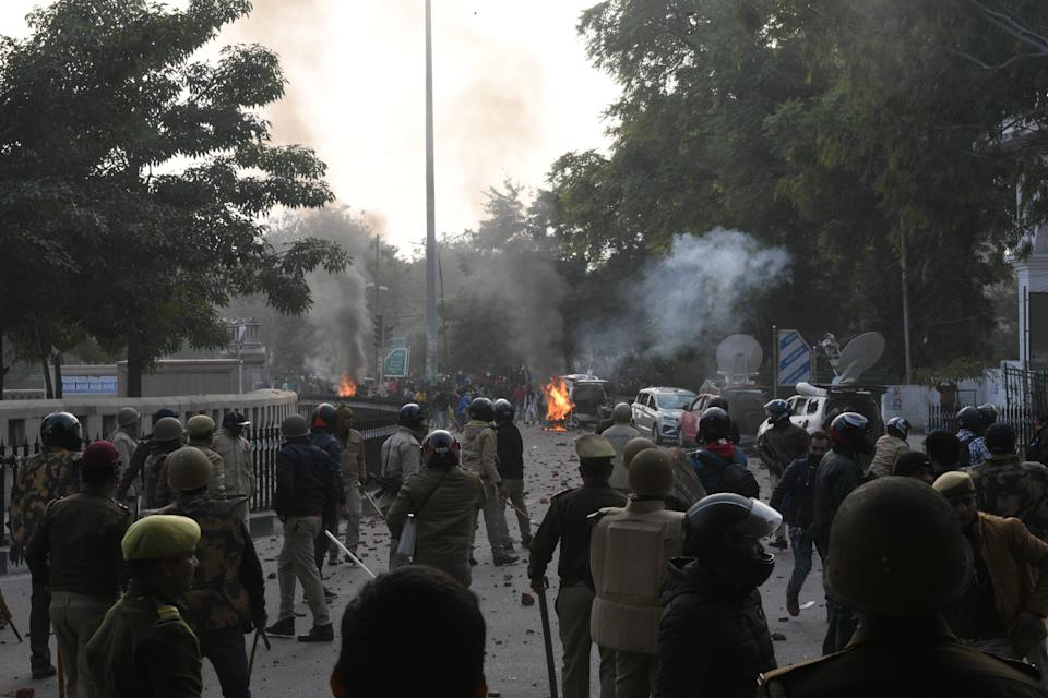 LUCKNOW, INDIA - DECEMBER 19: Demonstrators and police face off during an anti Citizenship Amendment Act (CAA) and National Register of Citizens (NRC) protest at Parivartan Chowk area on December 19, 2019 in Lucknow, India. The act seeks to grant Indian citizenship to refugees from Hindu, Christian, Sikh, Buddhist and Parsi communities fleeing religious persecution from Pakistan, Afghanistan, and Bangladesh, and who entered India on or before December 31, 2014. The Parliament had passed the Citizenship (Amendment) Bill, 2019 last week and it became an act after receiving assent from President Ram Nath Kovind. Since then, protests including some violent ones have erupted in various regions of the country, including the North East over the amended citizenship law. (Photo by Dheeraj Dhawan/Hindustan Times via Getty Images)