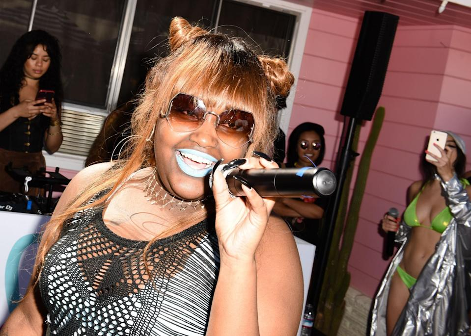 <p>The burnished orange hair color plays up this festivalgoer's topknots. (Photo: Getty Images) </p>