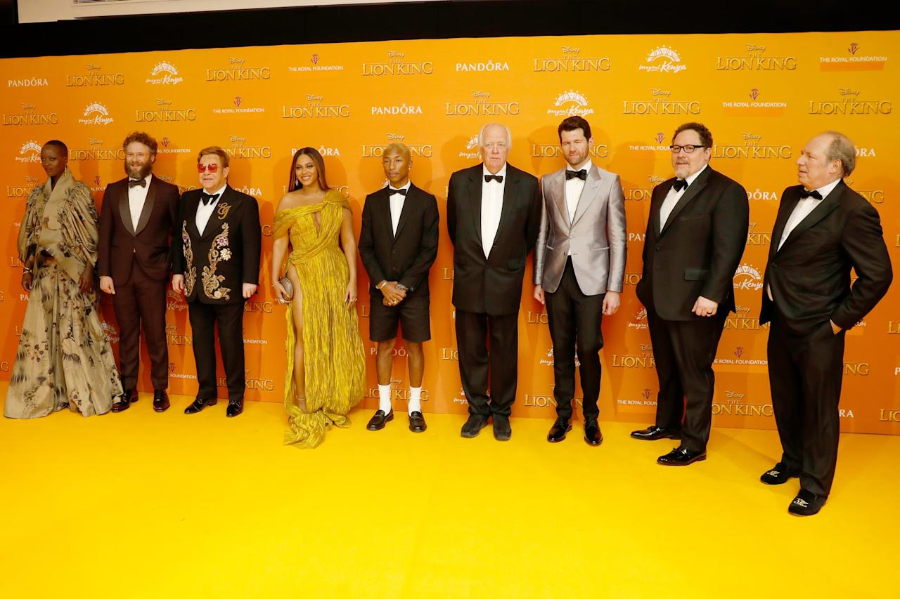 """<p>Pictured: Florence Kasumba, <a class=""""sugar-inline-link ga-track"""" title=""""Latest photos and news for Seth Rogen"""" href=""""https://www.popsugar.co.uk/Seth-Rogen"""" target=""""_blank"""" data-ga-category=""""Related"""" data-ga-label=""""https://www.popsugar.co.uk/Seth-Rogen"""" data-ga-action=""""&lt;-related-&gt; Links"""">Seth Rogen</a>, Elton John, Beyoncé, Pharrell Williams, Tim Rice, Billy Eichner, <a class=""""sugar-inline-link ga-track"""" title=""""Latest photos and news for Jon Favreau"""" href=""""https://www.popsugar.co.uk/tag/Jon-Favreau"""" target=""""_blank"""" data-ga-category=""""Related"""" data-ga-label=""""https://www.popsugar.co.uk/tag/Jon-Favreau"""" data-ga-action=""""&lt;-related-&gt; Links"""">Jon Favreau</a>, and Hans Zimmer at <strong>The Lion King</strong> premiere in London.</p>"""